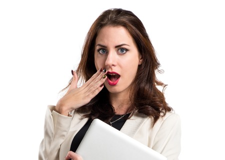 attractive  female: Surprised pretty young business woman with laptop Stock Photo