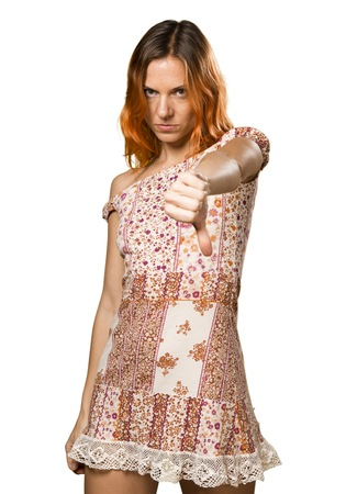 disapprove: Pretty woman with orange hair making bad signal Stock Photo