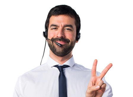 Young man with a headset doing victory gesture