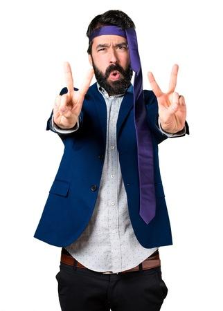 drunken: Crazy and drunk businessman making victory gesture Stock Photo