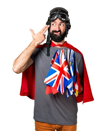 bilingual: Superhero with a lot of flags making suicide gesture Stock Photo
