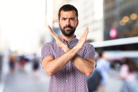 Handsome man doing NO gesture Stock Photo