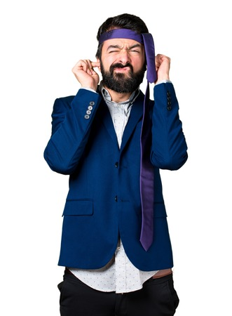 ignore: Crazy and drunk businessman covering his ears Stock Photo