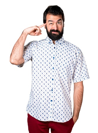 Handsome brunette man with beard making crazy gesture Stock Photo