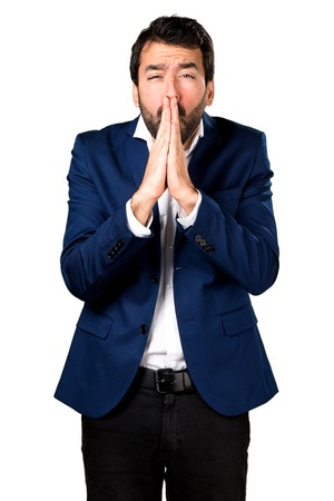 Handsome man pleading Stock Photo