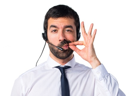 Young man with a headset making silence gesture Banco de Imagens - 72568546
