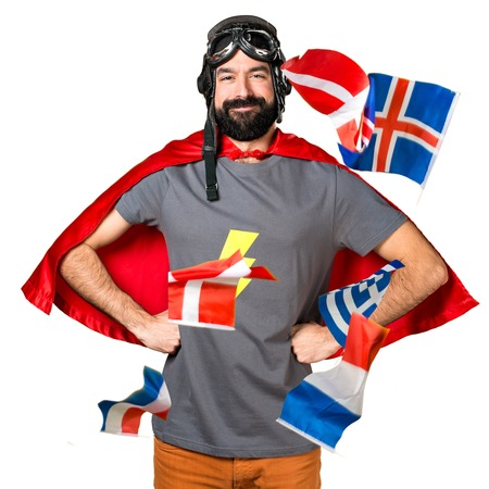 bilingual: Happy superhero with a lot of flags Stock Photo