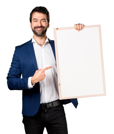 Handsome man holding an empty placard Stock Photo