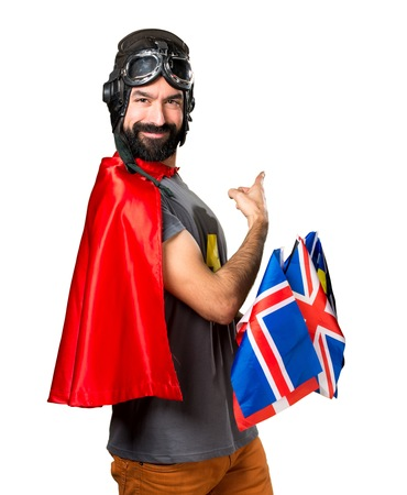 bilingual: Superhero with a lot of flags pointing back Stock Photo