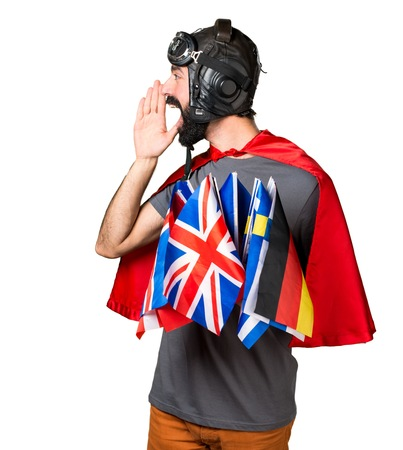 bilingual: Superhero with a lot of flags shouting
