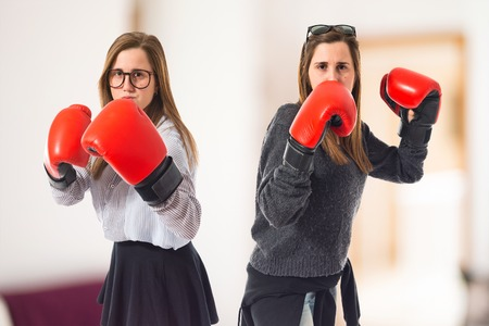 Twin sisters with boxing gloves Stock Photo