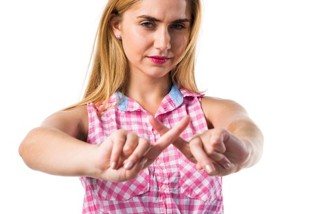Blonde girl doing NO gesture