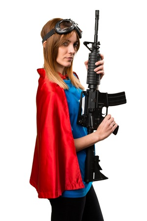 Pretty superhero girl holding a rifle