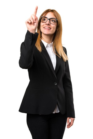 Young business woman touching on transparent screen Stock Photo