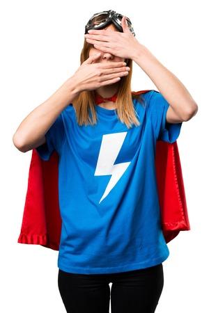 Pretty superhero girl covering her face Stock Photo