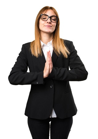 plead: Young business woman in zen position Stock Photo