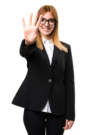 Young business woman counting four