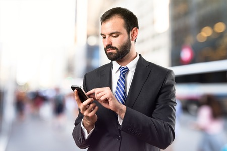 Business man sending a message over isolated background. Stock Photo