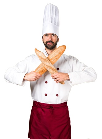 Young baker holding some bread making NO gesture Stock Photo
