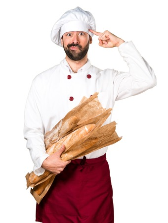 Young baker holding some bread and making crazy gesture