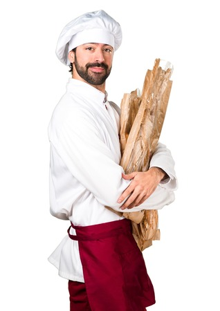 peo: Happy young baker holding some bread Stock Photo