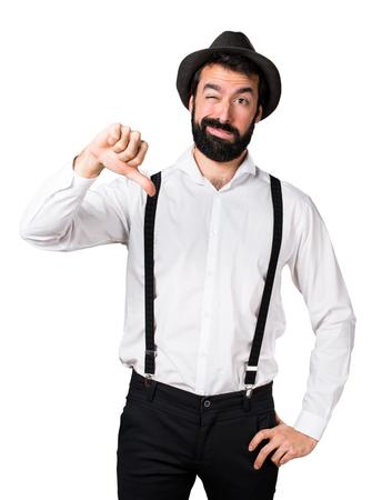 Hipster man with beard making bad signal