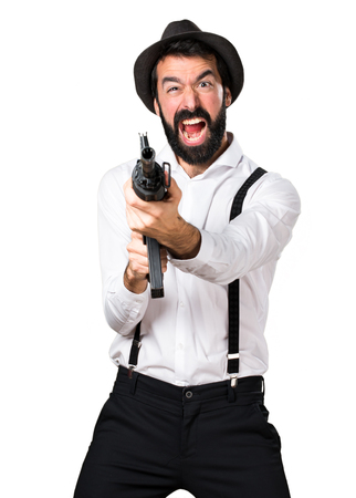Hipster man with beard holding a rifle