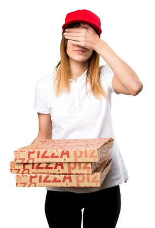 gesticulate: Pizza delivery woman covering her eyes