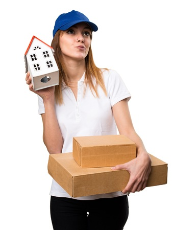 icone: Delivery woman holding a little house Stock Photo
