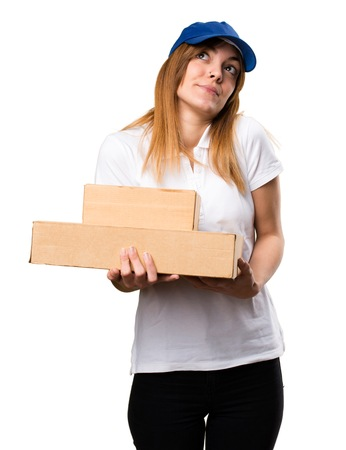 Delivery woman making unimportant gesture Stock Photo