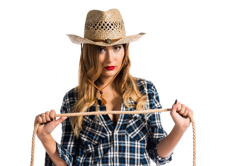 Sexy blonde woman cowgirl