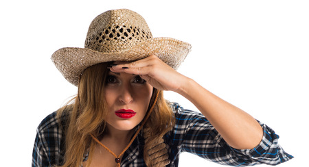 Sexy blonde woman cowgirl showing something