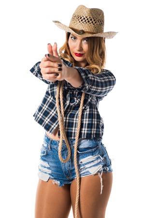 agressive: Sexy blonde woman cowgirl making gun gesture