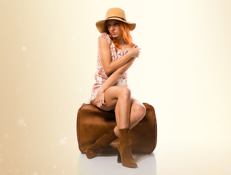 Beautiful russian woman with briefcase on ocher background