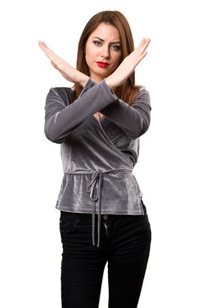 Beautiful young girl making NO gesture