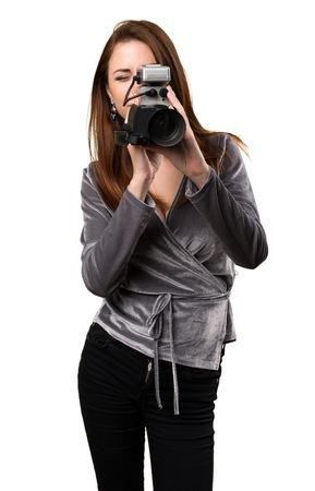 filmmaker: Beautiful young girl filming