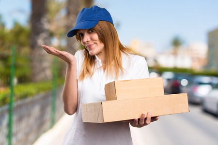 Delivery woman making unimportant gesture on unfocused background