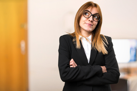 Young business woman making unimportant gesture on unfocused background