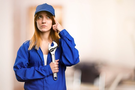 Delivery woman making crazy gesture on defocused background