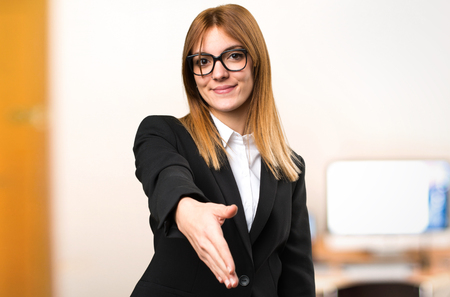 Young business woman making a deal on unfocused background