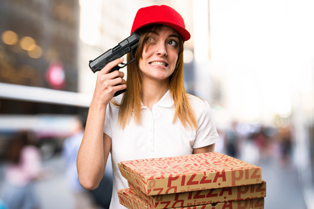 Pizza delivery woman cometing suicide on unfocused background Stock Photo