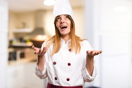 plead: Beautiful chef woman in zen position in the kitchen