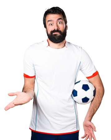 Football player holding a soccer ball making unimportant gesture