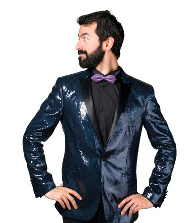 Handsome man with sequin jacket ooking lateral