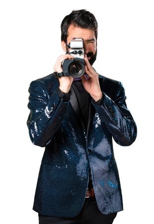 Handsome man with sequin jacket filming