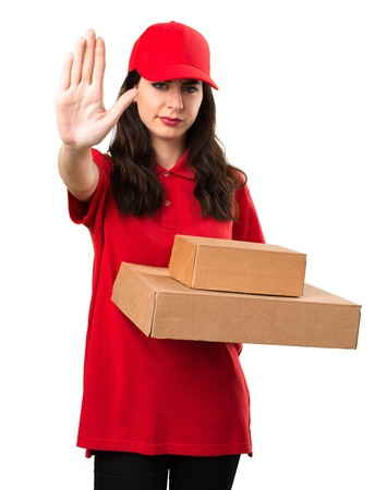 Young delivery woman making stop sign Stock Photo