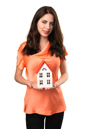 icone: Beautiful young girl holding a little house