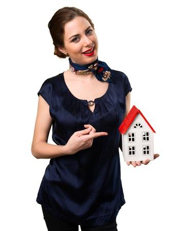 icone: Pretty stewardess holding a little house