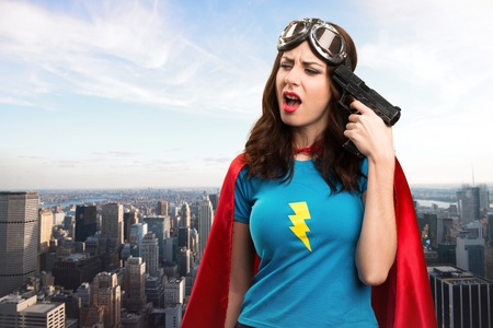 agressive: Pretty superhero girl cometing suicide with the city in the background