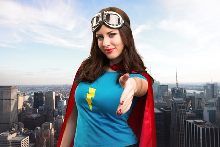 super woman: Pretty superhero girl making a deal with the city in the background